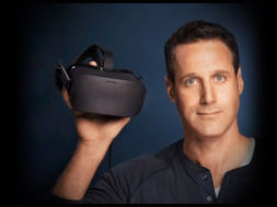 jason rubin holding oculus rift headset